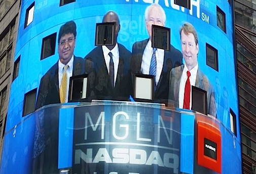 Magellan team on screen at NASDAQ