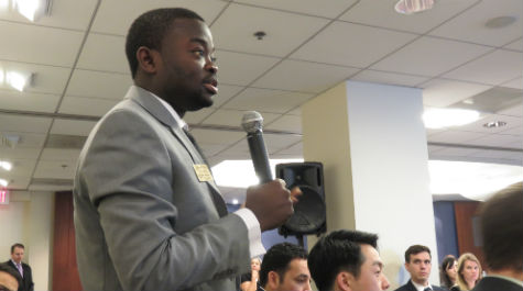 Student Albarou Sabi asks a question while visiting the Public Company Accounting Oversight Board (PCAOB).