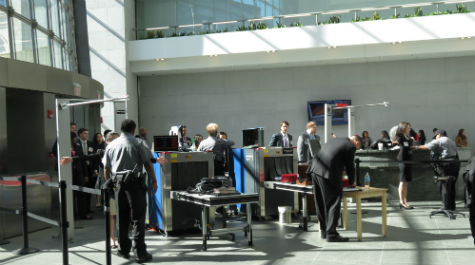 Students pass through security at the Securities & Exchange Commission (SEC).