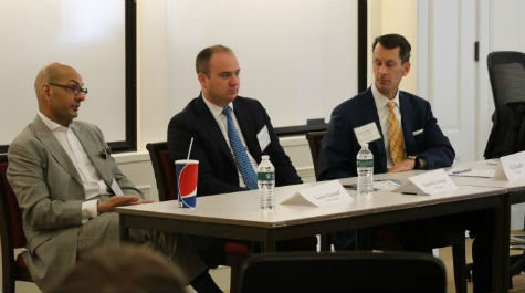 Eric Kauders '91, Harold Eylward '98, and Karim Ahamed '79 lead a session on Private Banking